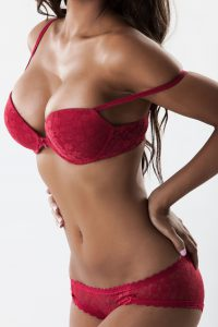 Mid Body Shot of Thin Woman in Rose Colored Lingerie