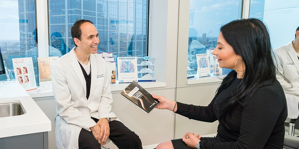 Dr. Bruno Discussing A Brazilian Butt Lift With An In-Office Patient